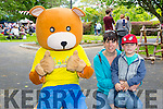 Niall O'Carroll and Trese O'Carroll from Tralee with Parky Bear at Feile na mBlath Park Festival in Tralee Town Park  on Saturday