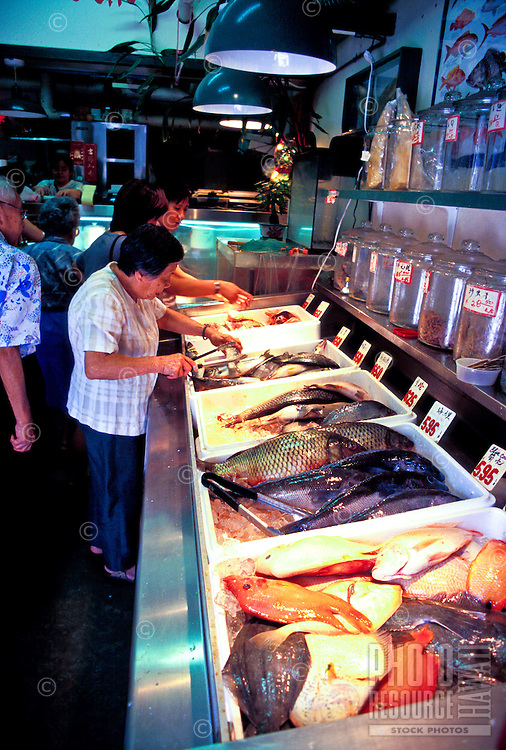 A wide variety of seafoods are available at the open markets in Chinatown, downtown Honolulu.