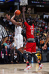 Codi Miller-McIntyre (0) of the Wake Forest Demon Deacons shoots over Mangok Mathiang (12) of the Louisville Cardinals during first half action at the LJVM Coliseum on January 4, 2015 in Winston-Salem, North Carolina.  The Cardinals defeated the Demon Deacons 85-76.  (Brian Westerholt/Sports On Film)