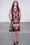 """Model Karime walks runway in a patchwork pepper motif shift dress in velvet and techno mesh in mulberry, from the Vivienne Tam Fall Winter 2016 """"Cultural Dreamland The New Silk Road"""" collection, presented at NYFW: The Shows Fall 2016, during New York Fashion Week Fall 2016."""