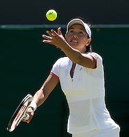 Shuai Peng (CHN) against Alexa Glatch (USA) in the first round of the ladies singles. Peng beat Glatch 6-4 2-6 6-4..Tennis - Wimbledon - Day 2 - Tues 23rd June 2009 - All England Lawn Tennis Club  - Wimbledon - London - United Kingdom..Frey Images, Barry House, 20-22 Worple Road, London, SW19 4DH.Tel - +44 20 8947 0100.Cell - +44 7843 383 012