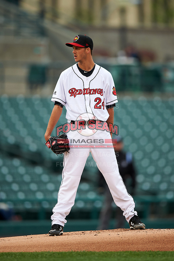 Rochester Red Wings pitcher Taylor Rogers (24) looks in for the sign during a game against the Toledo Mudhens on May 12, 2015 at Frontier Field in Rochester, New York.  Toledo defeated Rochester 8-0.  (Mike Janes/Four Seam Images)