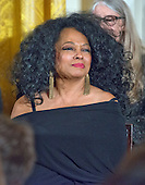 Singer Diana Ross looks on as United States President Barack Obama makes remarks at a ceremony in the East Room of the White House in Washington, DC where he is to present the Presidential Medal of Freedom, the Nation's highest civilian honor, on Tuesday, November 22, 2016.<br /> Credit: Ron Sachs / CNP