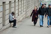 An elderly man begs in a street in central Tbilisi, Georgia.