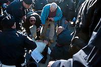 Roma 28 Novembre 2011.Inaugurata la nuova Stazione Tiburtina dell'alta velocità..Una donna  a terra dopo che ha tentato di bloccare l'automobile del Presidente della Repubblica Giorgio Napolitano