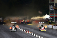 Aug. 3, 2013; Kent, WA, USA: NHRA top fuel dragster driver Tony Schumacher (left) races alongside Doug Kalitta during qualifying for the Northwest Nationals at Pacific Raceways. Mandatory Credit: Mark J. Rebilas-USA TODAY Sports