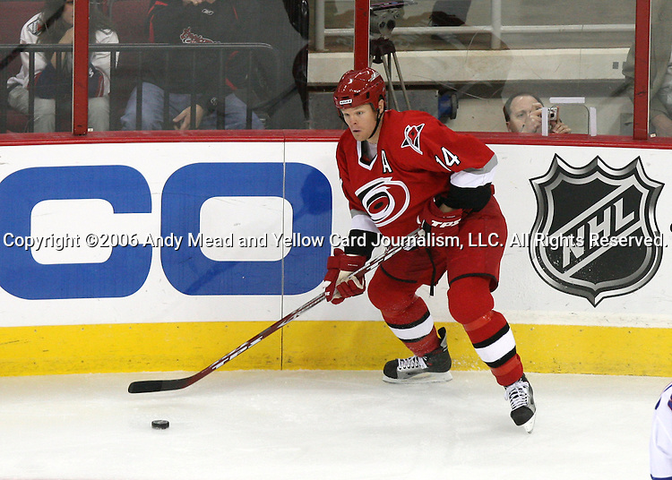 Carolina's Kevyn Adams on Tuesday, March 14, 2006 at the RBC Center in Raleigh, North Carolina during a regular season NHL game. The Carolina Hurricanes defeated the New York Rangers 5-3, setting franchise records for wins in a season (44) and home wins (27) in the process.