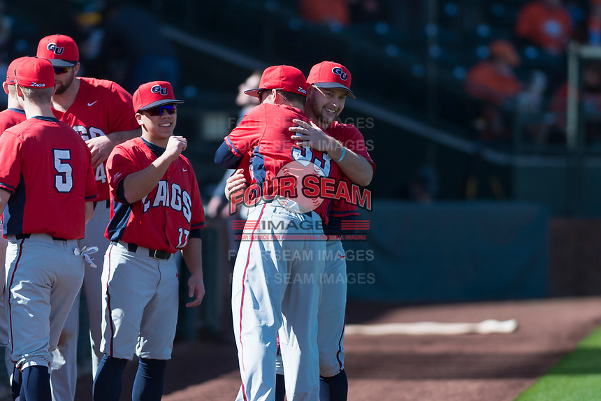 Gonzaga Bulldogs outfielder Jack Machtolf (24) hugs Slade Heggen (33) before a game against the Oregon State Beavers on February 16, 2019 at Surprise Stadium in Surprise, Arizona. Oregon State defeated Gonzaga 9-3. (Zachary Lucy/Four Seam Images)