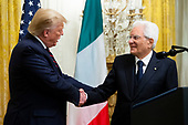 US President Donald J. Trump (L) shakes hands with the President of Italy Sergio Mattarella (R) at a reception in the East Room of the White House in Washington, DC, USA, 16 October 2019. US President Donald J. Trump hosted the President of Italy Sergio Mattarella and his daughter and Italy's First Lady Laura Mattarella at a reception held in honor of the Italian Republic.<br /> Credit: Michael Reynolds / CNP