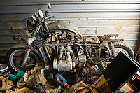 Abandoned Honda motorcycle left behind at Security Self Storage that suffered major damage due to Hurricane Katrina flooding in New Orleans East, Louisiana.