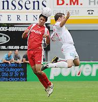 FC Gullegem - KSV Moorsele..luchtduel tussen Youssef Idrissi (links) en Christophe Cottyn (rechts)..foto VDB / BART VANDENBROUCKE