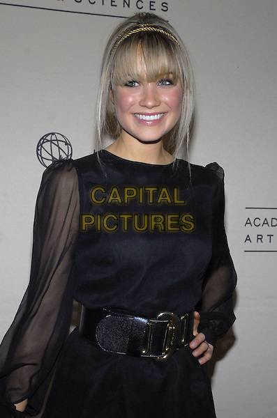 "KATRINA BOWDEN.The Academy of Television Arts & Sciences shows how ""work can be such a production"" as the organization presents An Evening with ""30 Rock"" at the Puck Building, New York, New York, USA..December 6th, 2007.half length black dress belt sheer sleeves headband gold hand on hip.CAP/ADM/BL.©Bill Lyons/AdMedia/Capital Pictures. *** Local Caption ***"