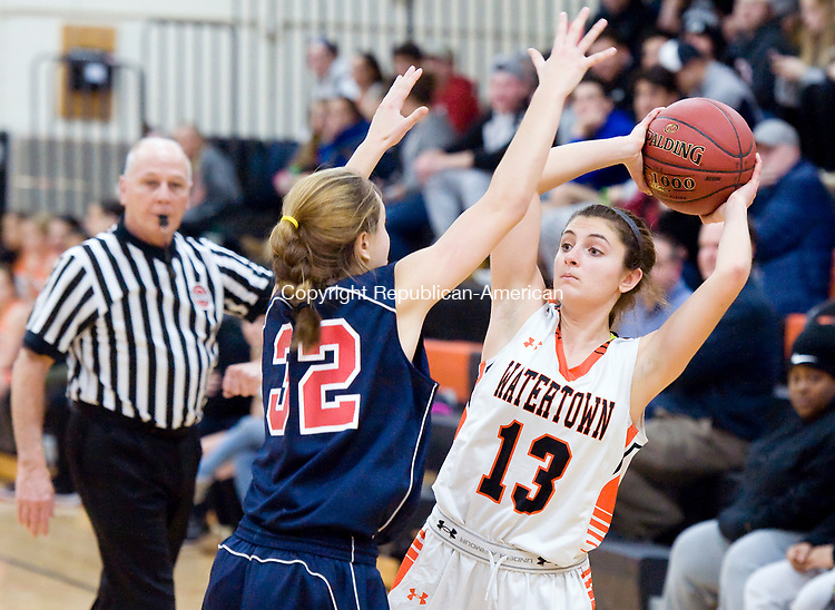 WATERTOWN, CT-011118JS05---Watertown's Brianna Nolan (13) looks to pass while being guarded by New Fairfield's Lauren Carter (32) during their non-league game Thursday at Watertown High School.<br />  Jim Shannon Republican-American