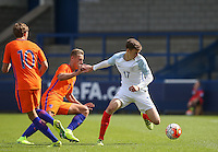 Sam Field (West Bromwich Albion) of England U19 holds off Kaj Sierhuis (Ajax) of Holland during the International match between England U19 and Netherlands U19 at New Bucks Head, Telford, England on 1 September 2016. Photo by Andy Rowland.