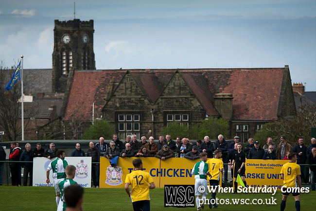 Spectators in the Chicken Run watching the first-half action at Mount Pleasant as Marske United (in yellow) take on Billingham Synthonia in a Northern League division one fixture. Formed in 1956 in Marske-by-the-Sea, the home club had secured automatic promotion to the Northern Premier League two days before and were in the midst of a run of six home games in 10 days as they attempted to overtake Morpeth Town to win the league. They won this match 6-1 against already relegated Billingham, watched by a crowd of 196.