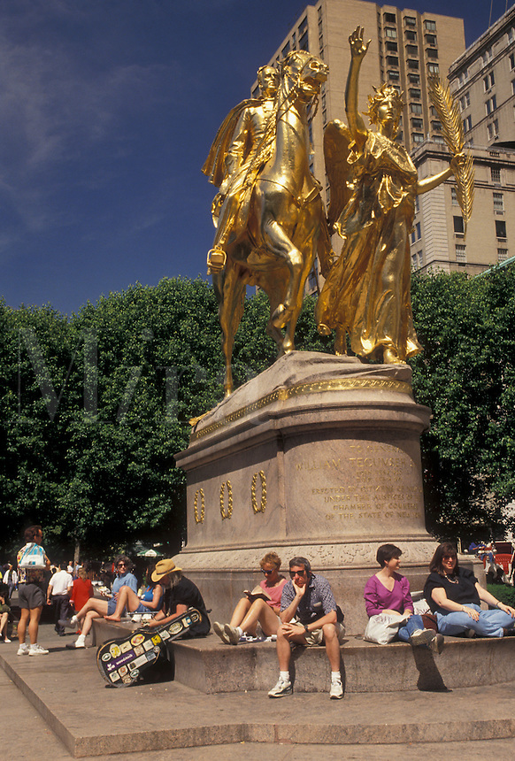 AJ4353, Central Park, New York City, Midtown Manhattan, statue, N.Y.C., New York, NYC, People relax on a sunny day around the gold equestrian statue of General William Tecumseh Sherman at Central Park in Midtown Manhattan in New York City in the state of New York.