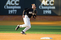 Shortstop Pat Blair #11 of the Wake Forest Demon Deacons tracks a fly ball against the Western Carolina Catamounts at Gene Hooks Field on February 22, 2011 in Winston-Salem, North Carolina.  Photo by Brian Westerholt / Four Seam Images