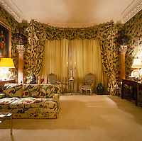 The bay window of the living room is decorated with an impressive pelmet and curtains in Michael Szell's signature chintz