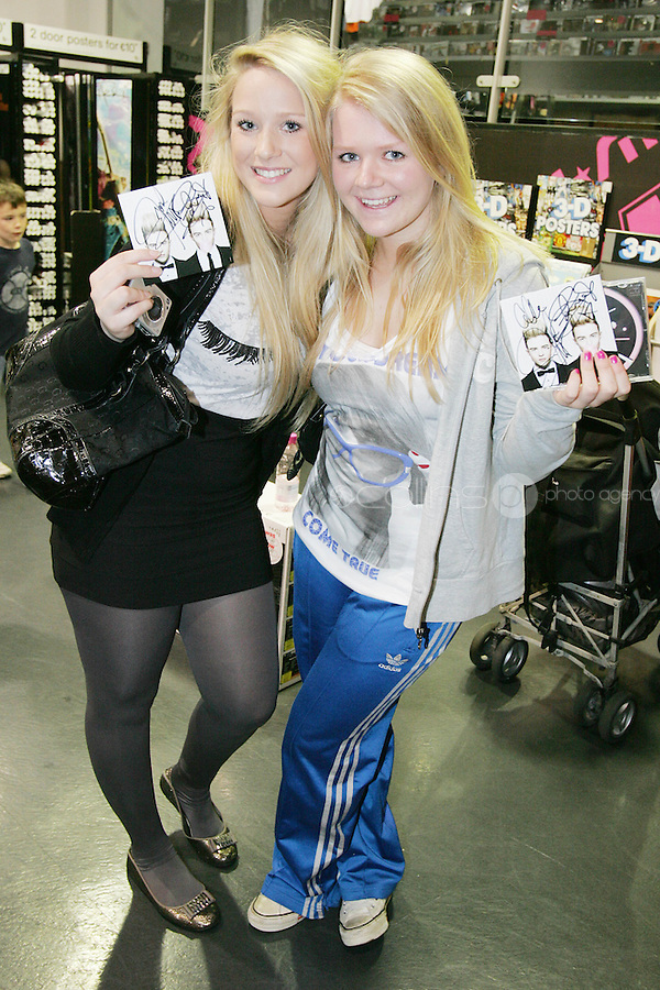 16/7/2010. Jedward fans Vicki Kearland and Debbie Fair are pictured at the launch of the new Jedward album at HMV Dundrum. Picture James Horan/Collins Photos