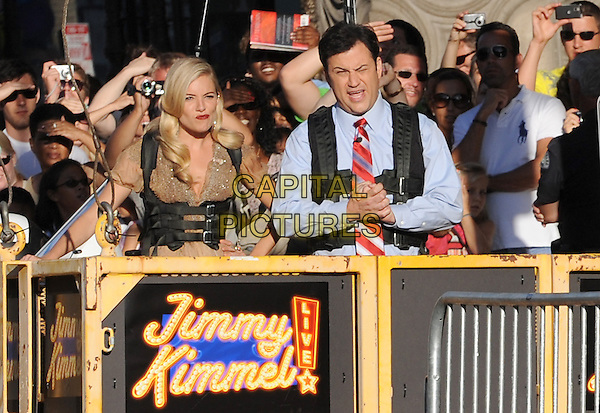 "SIENNA MILLER & JIMMY KIMMEL.""G.I. Joe: The Rise Of Cobra"" Los Angeles Premiere  held at Grauman's Chinese Theatre, Hollywood, CA, USA, .August 6th, 2009.half length balcony atmosphere cage mouth open funny face .CAP/DVS.©Debbie VanStory/Capital Pictures."