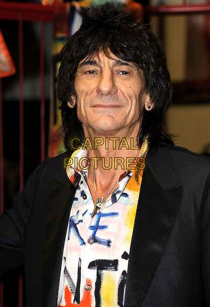 RONNIE WOOD.Photocall to launch Fashion Range for Liberty of London at Liberty, London, England..October 27th, 2009.headshot portrait black jacket white graffiti top blue pink yellow .CAP/CJ.©Chris Joseph/Capital Pictures.