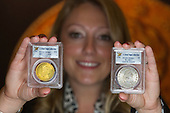 London, UK. 13 March 2015. Pictured: Stack's Bowers Galleries' auctioneer Melissa Karstedt holds up the 1795 Eagle (Ten Dollar Gold Piece) and the 1794 Silver Dollar, estimate USD 3-5 million. Sotheby's and Stack's Bowers Galleries will present the D. Brent Pogue Collection of masterpieces of United States coinage - the most valuable coin collection in private hands - across a series of seven auctions beginning 19 May 2015 at Sotheby's New York headquarters. The overall collection, which consists of more than 650 individual coins, is expected to achieve well in excess of USD 200 million - more than any other series of rare coin auctions in history. Photo: Bettina Strenske