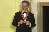 "Steven Spielberg shows off the medal he received from the British Ambassador, Sir Christopher Meyer KCMG, at the British Embassy in Washington, DC on January 29, 2001.  In his remarks the Ambassador said ""The award of an Honorary Knighthood to Steven Allan Spielberg is in recognition of his unique and outstanding contribution to international film, and in particular his services to the entertainment industry of the United Kingdom"".  He concluded by saying "" Mr. Spielberg epitomises the cultural partnership between our two countries.  I am privileged to present this historic award tonight on behalf of Her Majesty the Queen""..Credit: Ron Sachs / Pool via CNP"