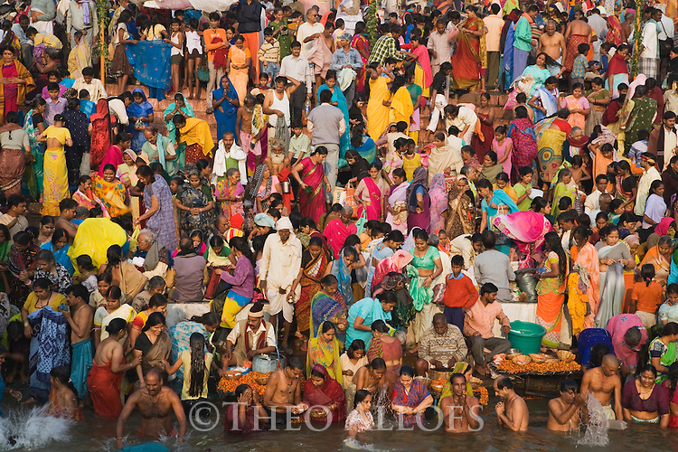 Thousands of people bathing in the Ganges River at the Main Ghat (stairs) early morning at the Full Moon Festival in November;  Varanasi has been a cultural and religious center in northern India for several thousand years, Varanasi, Uttar Pradesh, India