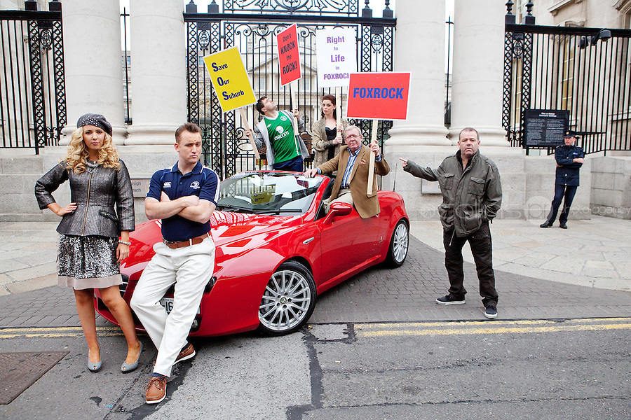 "NO FEE. 14/10/2010. SAVE OUR FOXROCK. The cast of Ross O'Carroll-Kelly play gather to protest outside Government Buildings to protest the recent decision to rezone Foxrock to Sandyford East as their play ""Between Foxrock and a hard place"" gets ready to open. L- R are Lisa Lambe, Rory Nolan {Ross O'Carroll-Kelly, Lawrence Kinlan, Aoibhinn McGinnity, Philip O Sullivan and Gary Cooke.  Picture James Horan/Collins Photos"