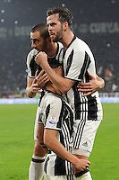 Calcio, semifinale di andata di Tim Cup: Juventus vs Napoli. Torino, Juventus Stadium, 28 febbraio 2017.<br /> Juventus' Paulo Dybala, center, celebrates with teammates Leonardo Bonucci, left, and Miralem Pjanic after scoring during the Italian Cup semifinal first leg football match between Juventus and Napoli at Turin's Juventus stadium, 28 February 2017.<br /> UPDATE IMAGES PRESS/Manuela Viganti