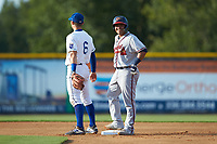 Victor De Hoyos (34) of the Danville Braves smiles as he stands on second base after hitting a double against the Burlington Royals at Burlington Athletic Stadium on July 13, 2019 in Burlington, North Carolina. The Royals defeated the Braves 5-2. (Brian Westerholt/Four Seam Images)