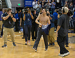 Nevada's head coach Eric Musselman, center, celebrates shirtless after defeating Colorado State in an NCAA college basketball game in Reno, Nev., Sunday, Feb. 25, 2018. (AP Photo/Tom R. Smedes)