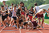 """Pile Up"".Competitors go down as teams handing off get too close during 4 X400 relay at the NJSIAA Meet of Champions. 06/03/10"