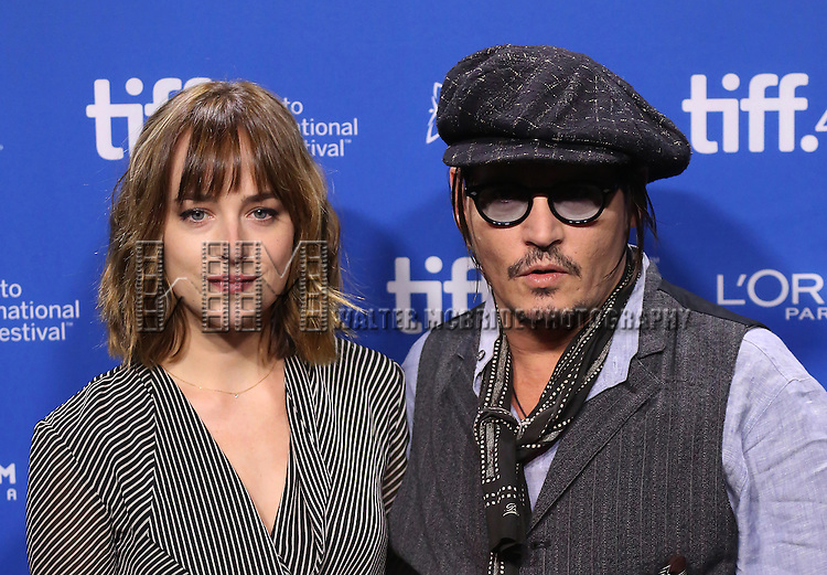 Dakota Johnson and Johnny Depp attend the 'Black Mass' photo call during the 2015 Toronto International Film Festival at Roy Thomson Hall on September 14, 2015 in Toronto, Canada.
