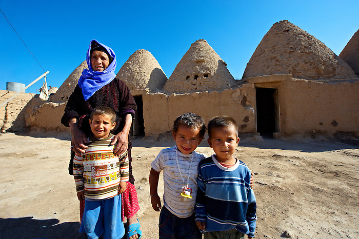 """Pictures of the beehive adobe buildings of Harran, south west Anatolia, Turkey.  Harran was a major ancient city in Upper Mesopotamia whose site is near the modern village of Altınbaşak, Turkey, 24 miles (44 kilometers) southeast of Şanlıurfa. The location is in a district of Şanlıurfa Province that is also named """"Harran"""". Harran is famous for its traditional 'beehive' adobe houses, constructed entirely without wood. The design of these makes them cool inside. 28"""