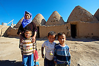 "Pictures of the beehive adobe buildings of Harran, south west Anatolia, Turkey.  Harran was a major ancient city in Upper Mesopotamia whose site is near the modern village of Altınbaşak, Turkey, 24 miles (44 kilometers) southeast of Şanlıurfa. The location is in a district of Şanlıurfa Province that is also named ""Harran"". Harran is famous for its traditional 'beehive' adobe houses, constructed entirely without wood. The design of these makes them cool inside. 28"