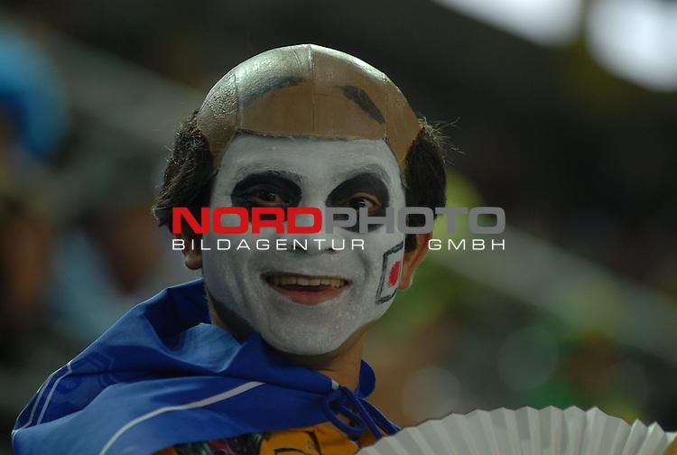 FIFA WM 2006 -  Gruppe F Vorrunde ( Group AF)  Feature<br /> Play   #43 (22-Jun) - Japan vs Brasilien  1 - 4<br /> <br /> A happy Fan from Japan.<br /> <br /> Foto &copy; nordphoto