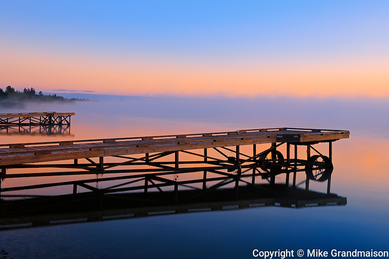 Dock in fog at sunrise on Sturgeon Lake<br />