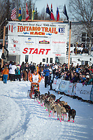 Jake Berkowitz leaves the start line on Willow Lake during the re-start of the Iditarod sled dog race Sunday, March 3, 2013.