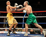 GLASGOW, SCOTLAND - MARCH 10: Gary O'Sullivan (green shorts) lands a punch on Paul Morby (gold shorts) during a Welterweight contest on the Ricky Burns undercard at the Braehead Arena on March 10, 2012 in Glasgow, Scotland. (Photo by Rob Casey/Getty Images)