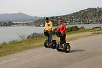 Couple on Segways, each on a Segway, on Angel Island State Park in San Francisco Bay, California, CA. Model released..Photo camari208-70401..Photo copyright Lee Foster, www.fostertravel.com, 510-549-2202, lee@fostertravel.com.