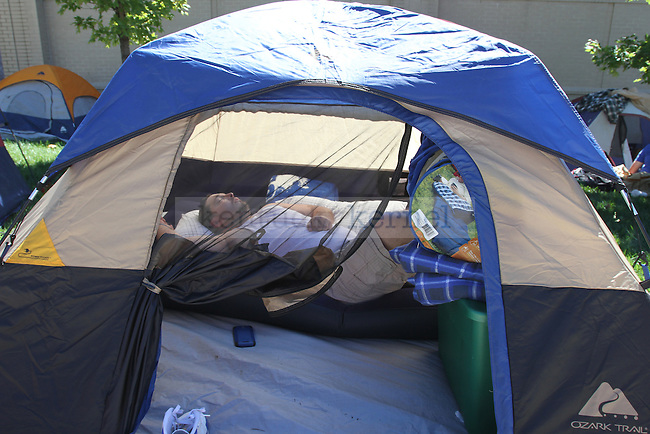 A wildcat fan takes a nap while camping outside Memorial Coliseum for Big Blue Madness tickets on Wednesday, Sept. 19, 2012. Photo by Kirsten Holliday | Staff