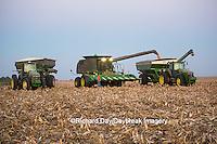 63801-06806 John Deere combine unloading corn into wagon, Marion Co., IL