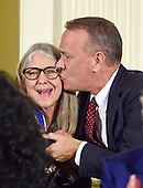 Tom Hanks kisses computer scientist Margaret H. Hamilton after she received the Presidential Medal of Freedom from United States President Barack Obama during a ceremony in the East Room of the White House in Washington, DC on Tuesday, November 22, 2016.  The Presidential Medal of Freedom is the Nation's highest civilian honor.<br /> Credit: Ron Sachs / CNP