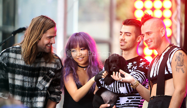 NEW YORK, NY-August 26: Jack Lawless,JinJoo Lee, Joe Jonas, Cole Whittle of DNCE performed NBC's Today Show Citi Concert Series at Rockefeller Center in New York. NY August 26, 2016. Credit:RW/MediaPunch