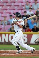 Seth Harrison #22 of the Salem-Keizer Volcanoes bats against the Spokane Indians at Volcanoes Stadium on July 26, 2014 in Keizer, Oregon. Spokane defeated Salem-Keizer, 4-1. (Larry Goren/Four Seam Images)