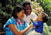 YOUNG RACIALLY MIXED FAMILY WITH THEIR INFANT SON. YOUNG FAMILY. OAKLAND CALIFORNIA USA PARK.