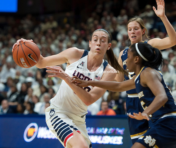 STORRS, CT--- -12015JS09--UConn's Breanna Stewart (30) drives to the basket on Notre Dame's Lindsay Allen (5) during their game Saturday at Gampel Pavilion in Storrs. <br /> Jim Shannon Republican-American