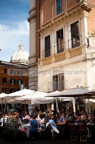 People dining outdoors in a cafe at Campo Dei Fiori, Rome, Italy