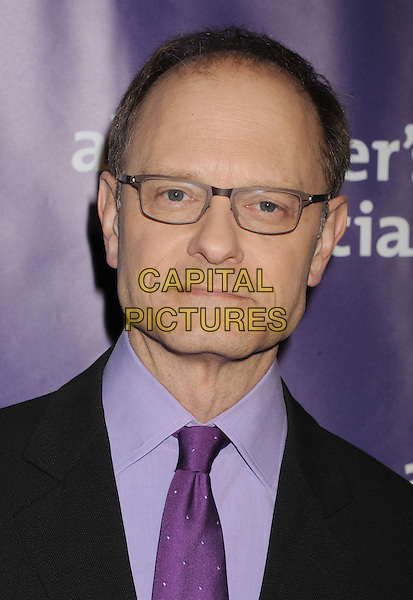 "David Hyde Pierce.arriving at the 20th Anniversary Alzheimer's Association ""A Night At Sardi's"" at The Beverly Hilton Hotel in Beverly Hills, California, USA, .March 21st, 2012..portrait headshot glasses black suit purple tie .CAP/ROT/TM.©TM/Roth Stock/Capital Pictures"
